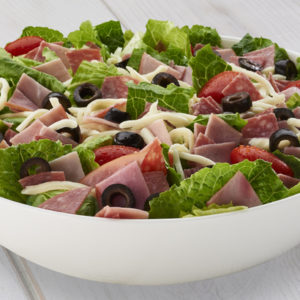 Lettuce, tomato, red onion, black olives, mushroom, ham, pepperoni, salami, Canadian bacon, peperoncino and green bell peppers.