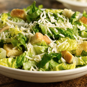 Lettuce, croutons, Parmesan cheese and Caesar dressing.