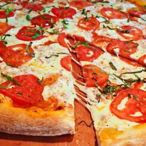 Red sauce, mozzarella cheese, fresh tomato and garlic. Any specialty pizza can be made cheese less.