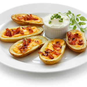 Loaded with mozzarella and cheddar cheese topped with bacon and sour cream.
